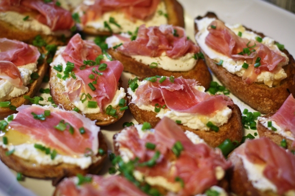 Ricotta, honey and proscuitto crositini
